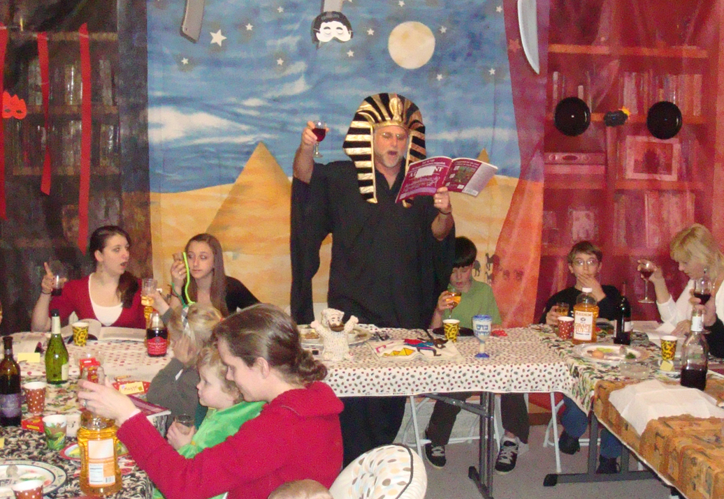 Rabbi Weis, center, leads a Seder in costume.