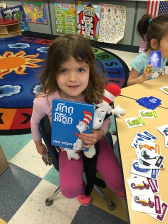 "Katz JCC Sari Isdaner Early Childhood student Shir Elia, 5, reads ""The Cat in the Hat"" in Hebrew in honor of Dr. Seuss' birthday. The school celebrated the occasion with a special visit and book reading from ""The Cat in the Hat."""
